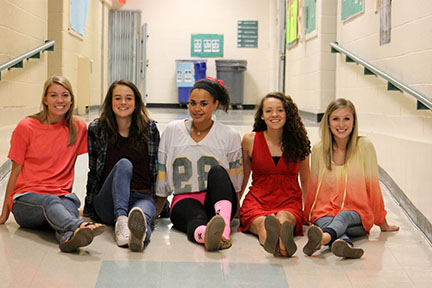 Kelsey Hartwig (12), Avery Norwood (10), Mahalia Henschel (12), Bella Gallardo (12), and Paige McKenna (11), all wear their clothes inside out in honor of  the first day of homecoming week.