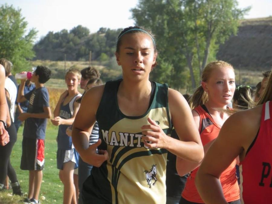 Jone Cole (11) breaks through the pack to take the lead over the Mustangs temporarily during the race. Her finishing time made her the second girl on the team to beat the 22 minute barrier.