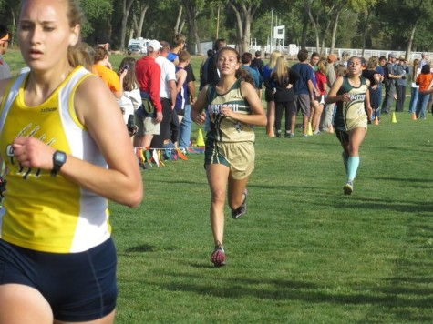 Brooklyn Mack (10) nudges out Jen Cole (11) in the final moments at the Tri Peak meet. Both girls ran in the low 21 minute range to lead the team to a second place league title.