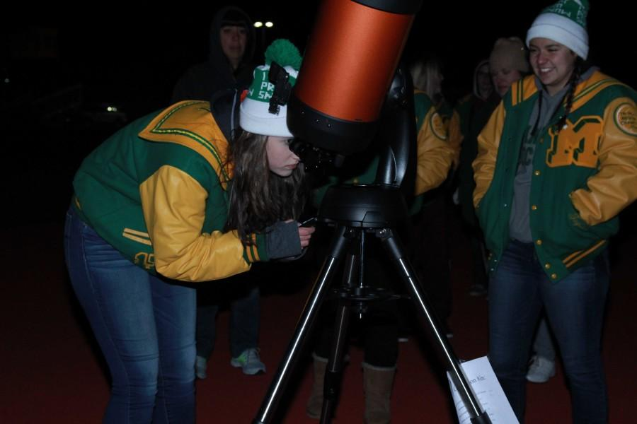 Shelby Hard (12) looks through the new computerized telescope.