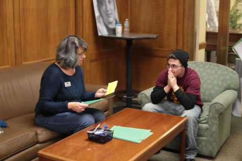 Wyatt Fries (12) talks to a representative of Urban Peak during the homelessness simulation. In the simulation, Fries was a homeless male searching for a job, which involved finding references and an address to use on applications.