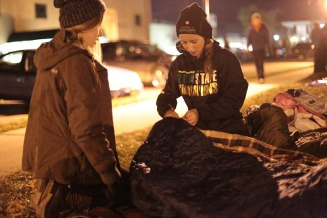 Aubrey Hall (10) and Lily Reavis (11) wrestle with Hall's sleeping bag. The bag's zipper fell off right before the night was supposed to begin. Under the sleeping bags, the students slept on sleeping mats and a tarp.