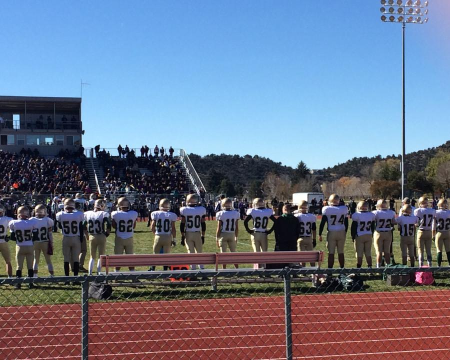 The+Mustangs+stand+together+to+recite+the+Pledge+of+Allegiance+before+the+game.+