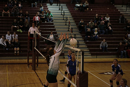 Seniors Angala Jensen and Brooke Garretson block the ball coming from Grandview.