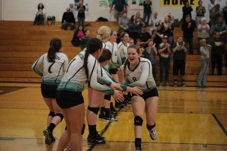 McKayla Cully (9) high-fives her teammates. She is the only freshman on this year's varsity team.