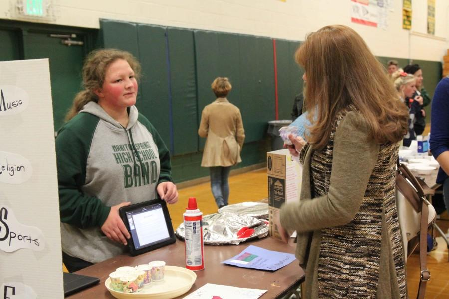 Amyjoy Holler (10) presents during Language Night, using her iPad.