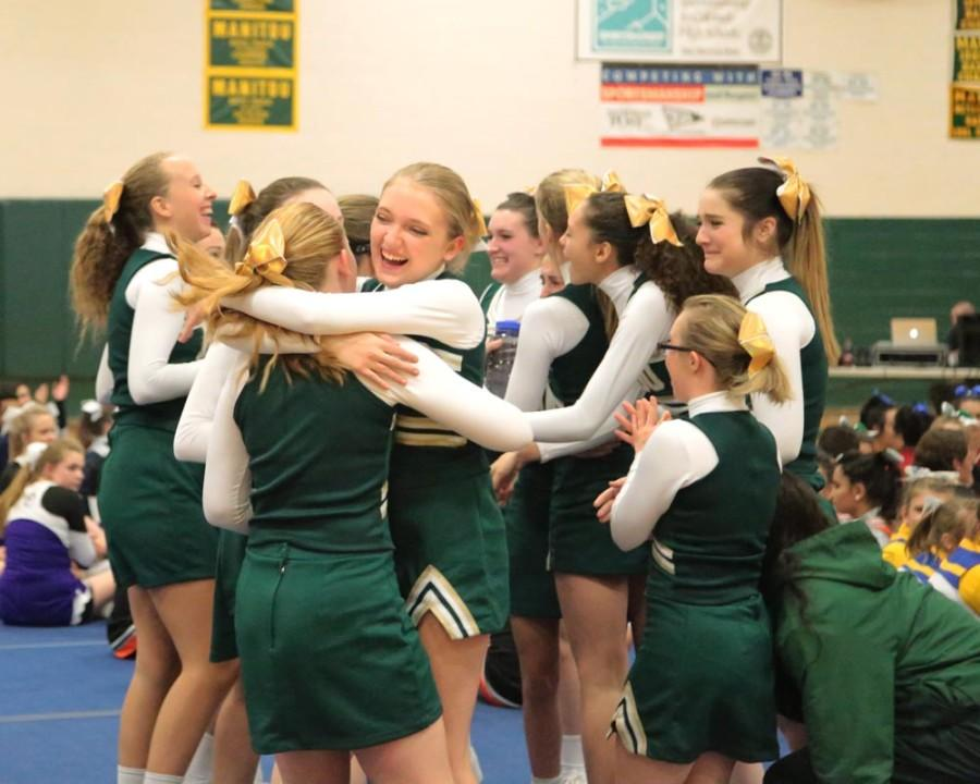 The team celebrates after being announced the Tri-Peaks League 3A League Champions. In the front, newcomers Zoe Schnurman (10) and Brooke Sedlacek (9) hug in excitement.
