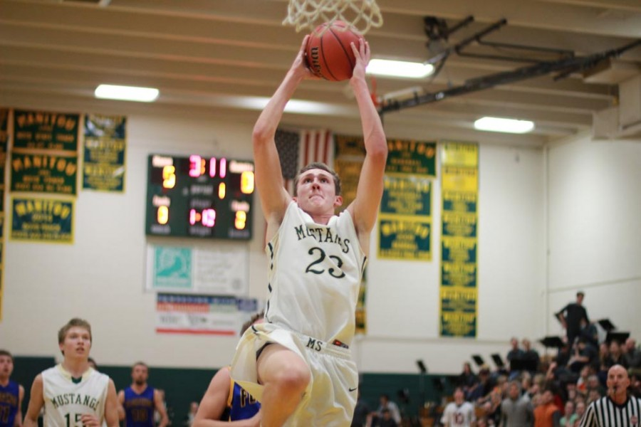 Lucas Rodholm (11) makes a slam dunk during the first quarter of the game. Rodholm's point-per-game average this season is far above the national average. He scored a total of 15 points throughout the course of Friday night's game.