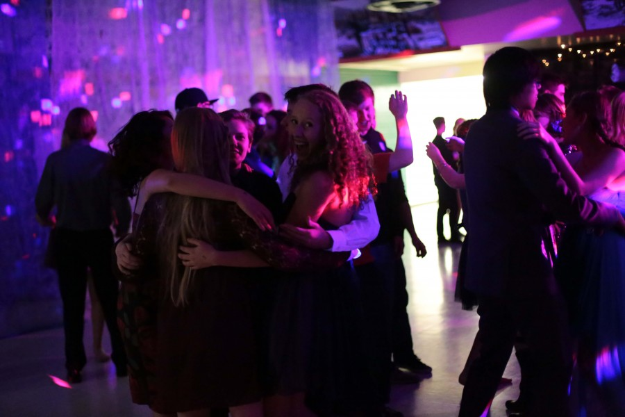 A group comprised of Mia Elliot (12), Aubrey Hall (10), Lily Reavis (11) and Caleb Hall (11) hold each other in an embrace during the dance.