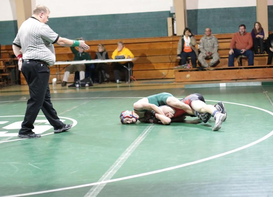 Tanner Webber (12), weight 126, pins down his opponent