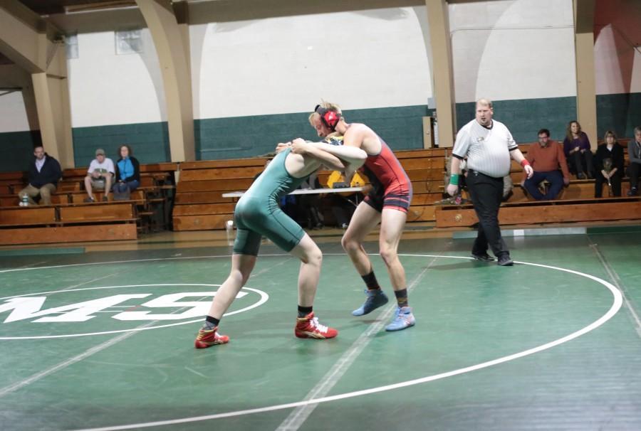 Atticus Fredrickson (11), at weight 182, wrestling against Peyton