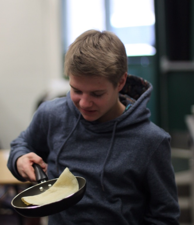Quinn Hersey makes crepes in his French II class