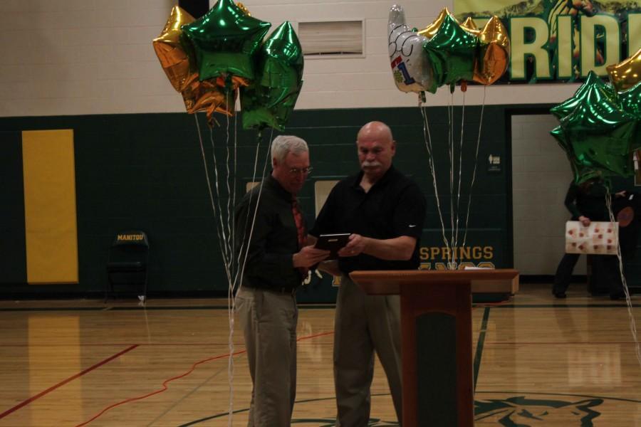 Coach Jo receives an award for the countless years that he spent as a coach and teacher.