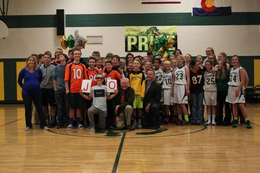 After the game, Mr. Jo and his past students stand for a photo.