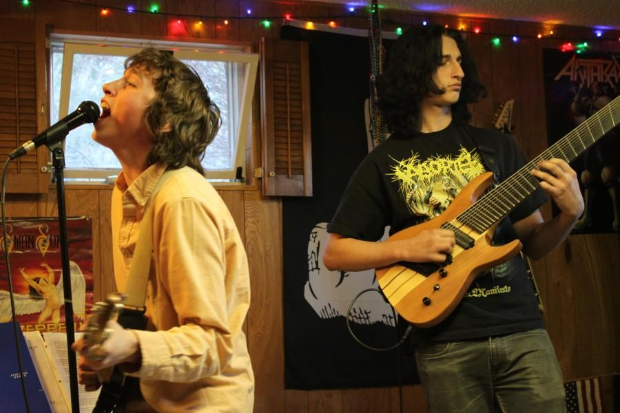 Hunter Bogush (12) (left) and Darrin Proudfoot (11) (right) jam to their original song, Stickmen.