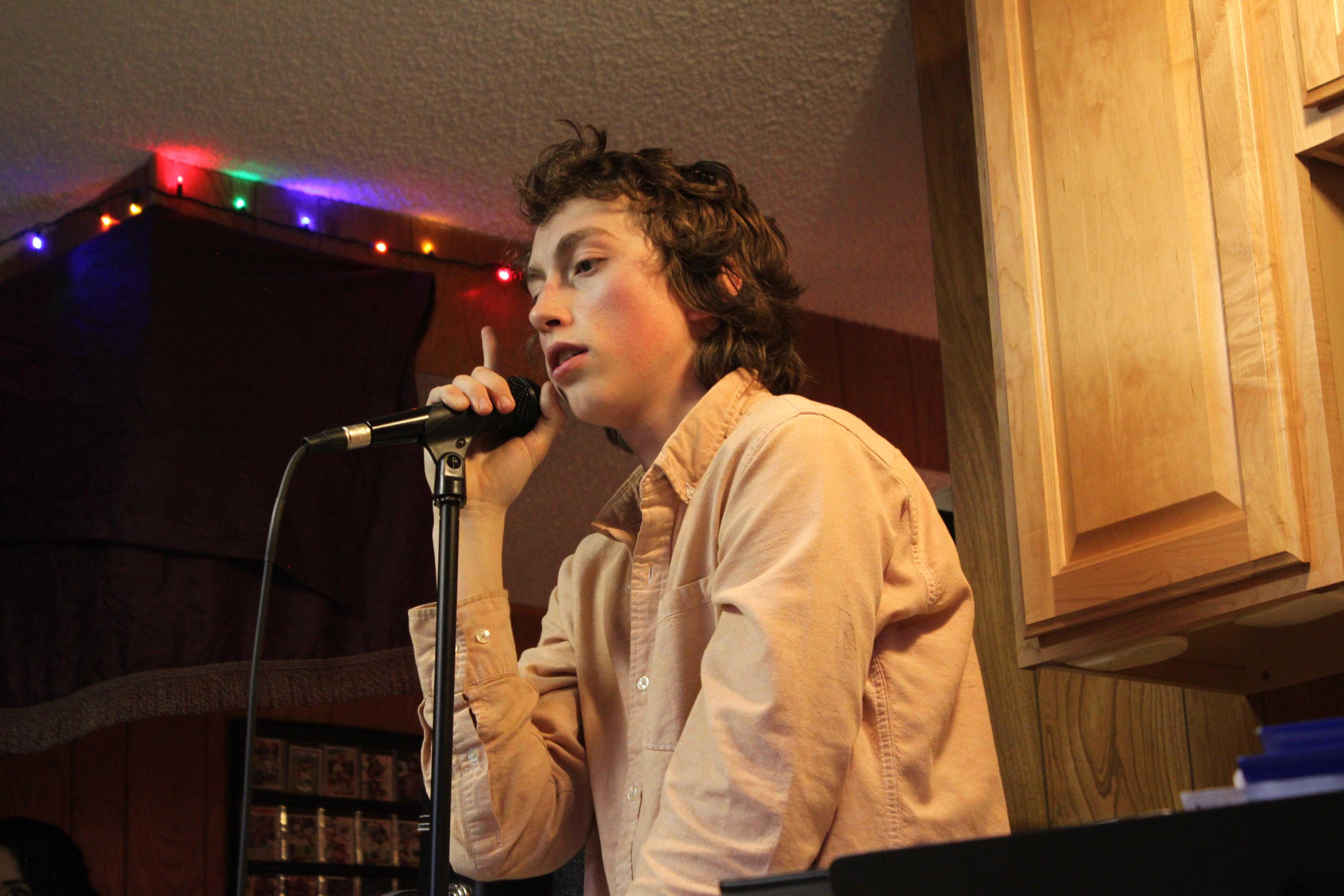 Hunter Bogush (12) listens as the band's original,