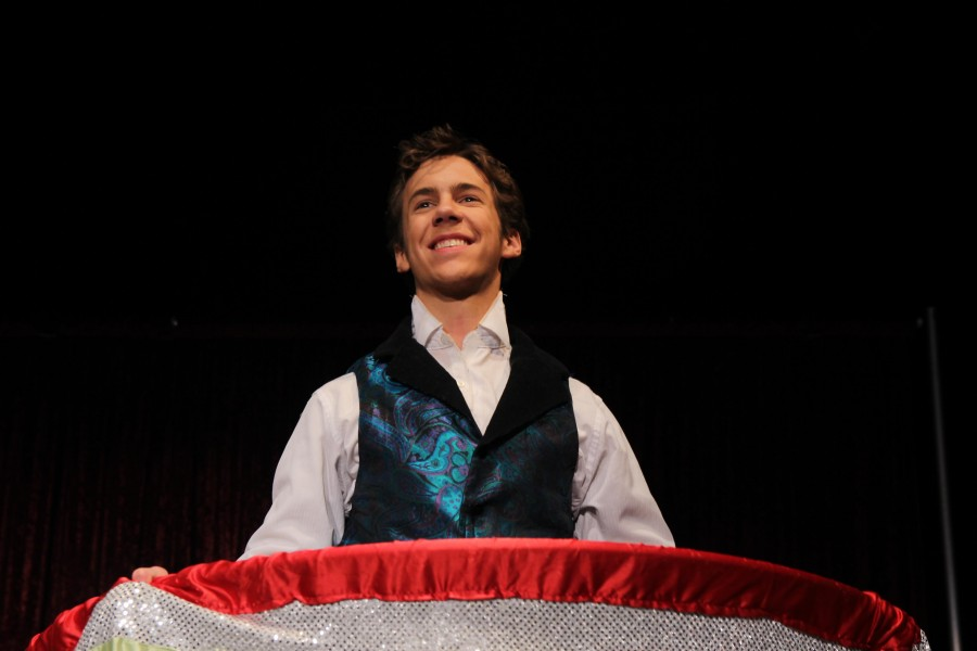 Harry Houdini, played by Bennett Cross (12), performs the metamorphosis magic trick. Cross won a honorable mention for best actor in a lead role at the one act competition.