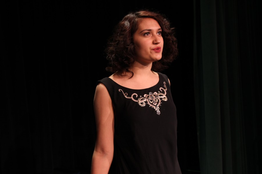 Margery Crandon, played by Mia Elliott (12), discusses her ability to contact the spirit world. Elliott is Drama Club president.