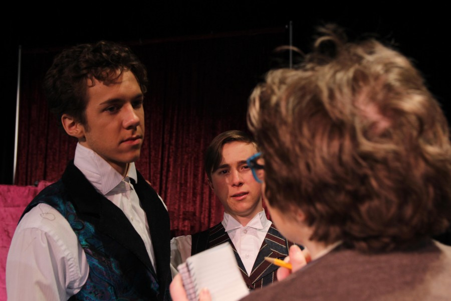 A reporter, played by Cicada Dawn (12), interviews Houdini (Cross) and his manager (Baker) about disproving Margery Crandon (Elliott).