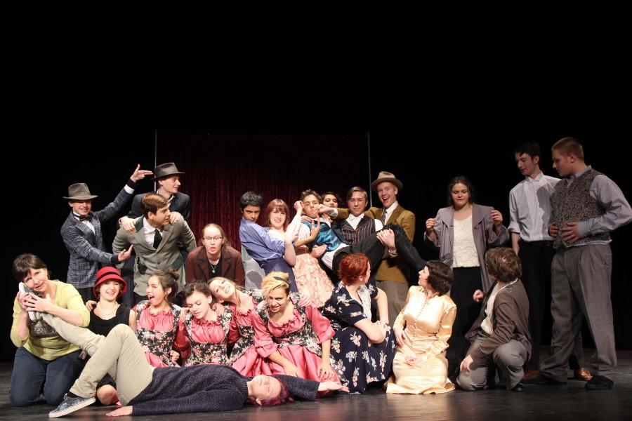 The cast poses for a photo.