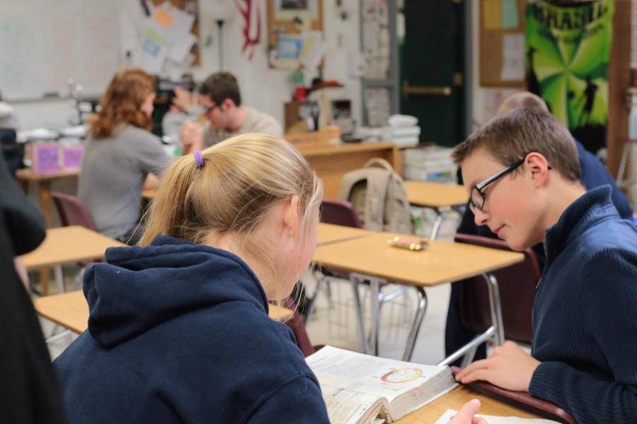 James Baker (10) and Naiya Budler (10) work together on Honors Biology homework during advisory. Baker, who took biology last semester, was helping Budler with a question on cell reproduction. Budler says that she has 1 hours of homework night.