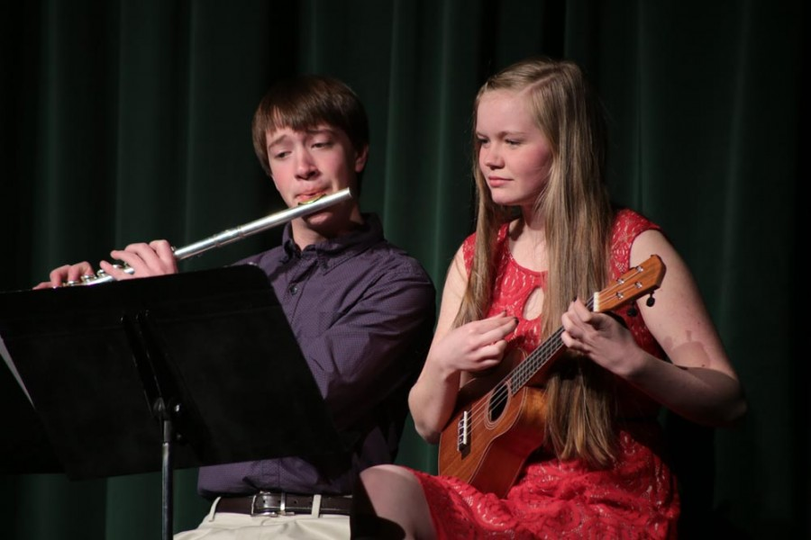 Paxton Wolf (10) and Alena Akse (10) perform an instrumental rendition of,