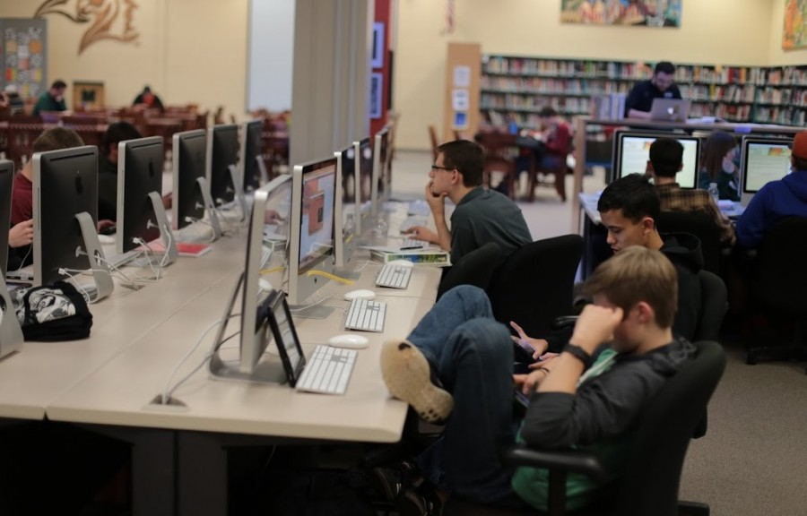 Students work in the media center during fourth block