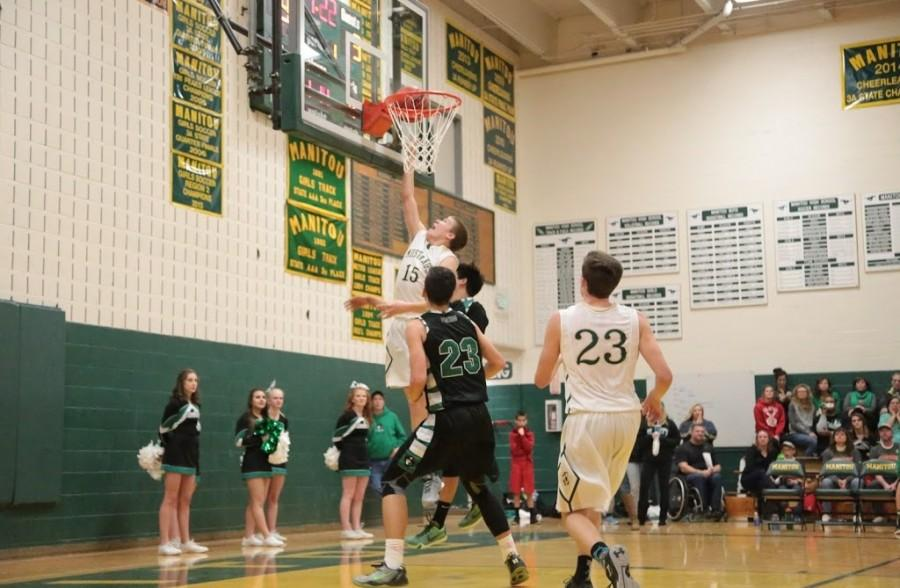Cole Sienknecht (10) makes a layup. Sienknecht was a key player throughout the game.