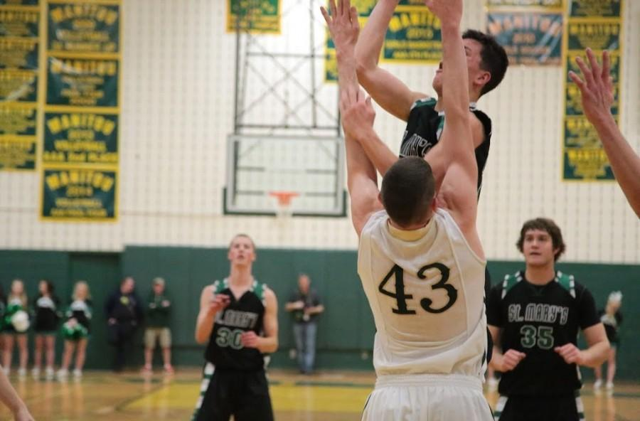 Steven Jensen (12) defends a rebound made by St. Mary's