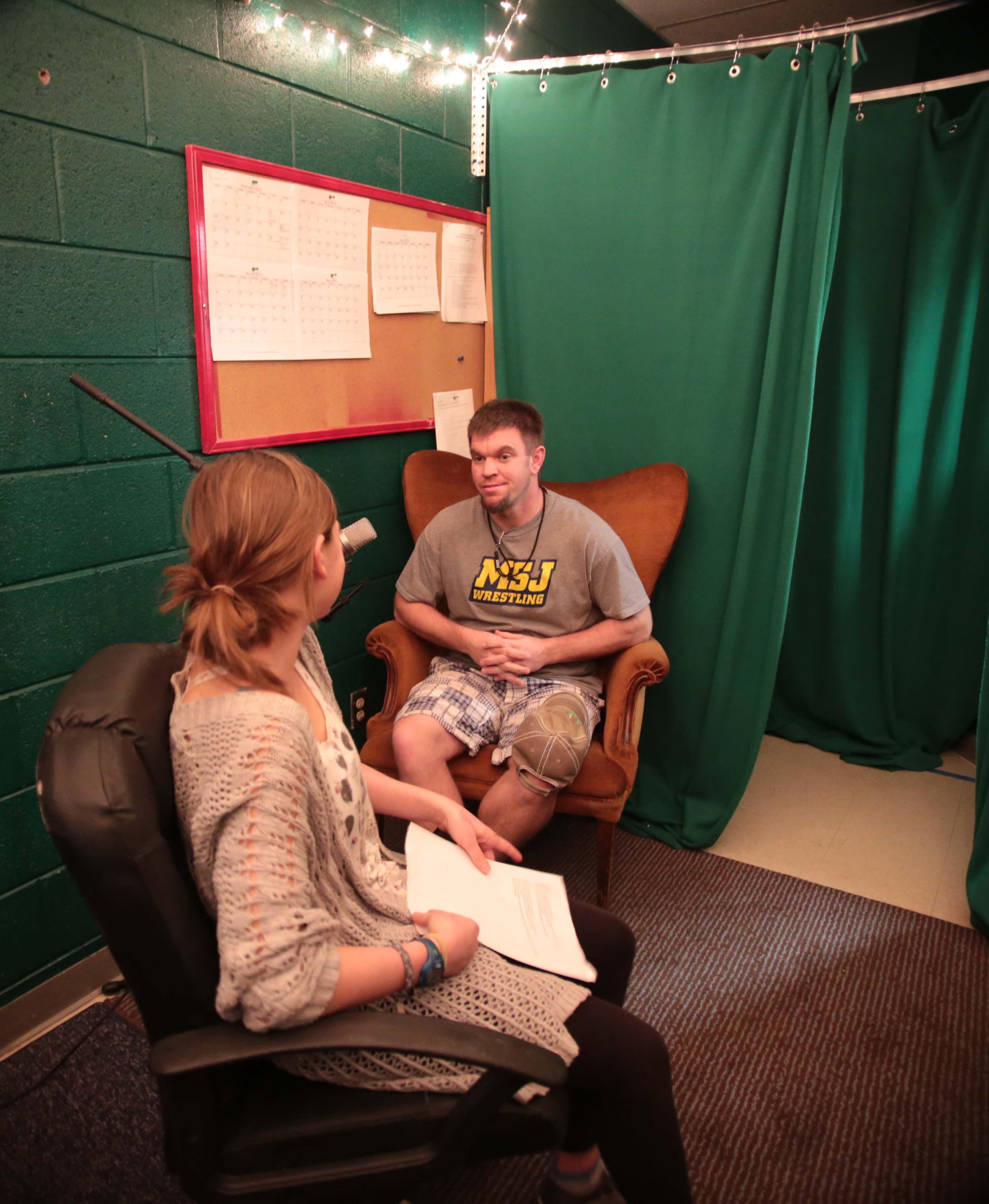 Kaitlyn Davidson (10) interviews Mr. Gutowksi.