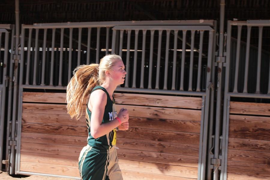 Naiya Budler (10) runs at a State race. Budler has been running since her freshman year, and aspires to continue.