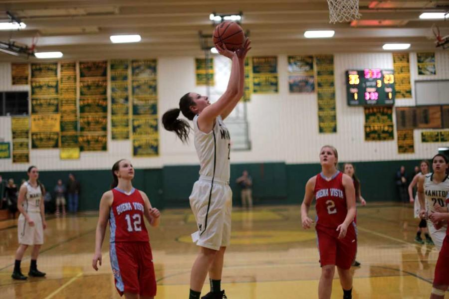 Ariana Olson(11) goes up for a layup in the first round of Districts against Buena Vista. The Mustangs won this game 68-36.
