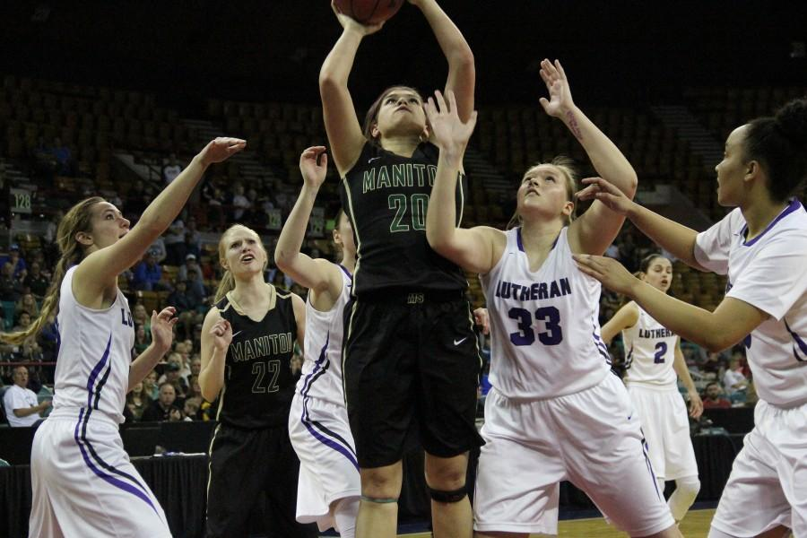 Angala Jensen (12) goes up for a layup in the championship game. Jensen lead the Mustangs with 15 points.