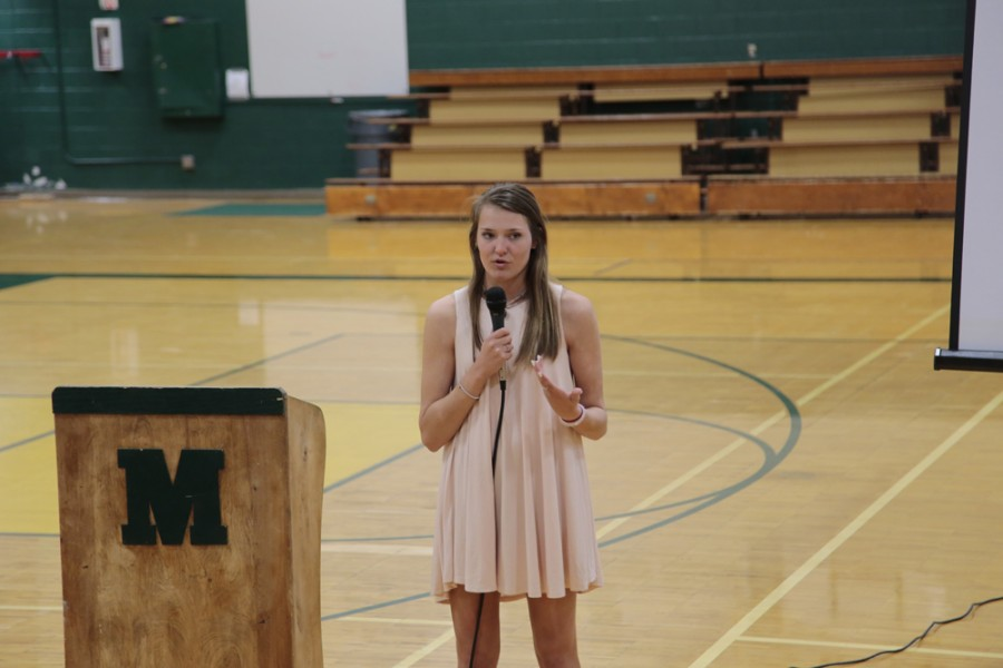 Taylor Finn (12) sends the assembly attendees off, urging them to drive with caution, asking,