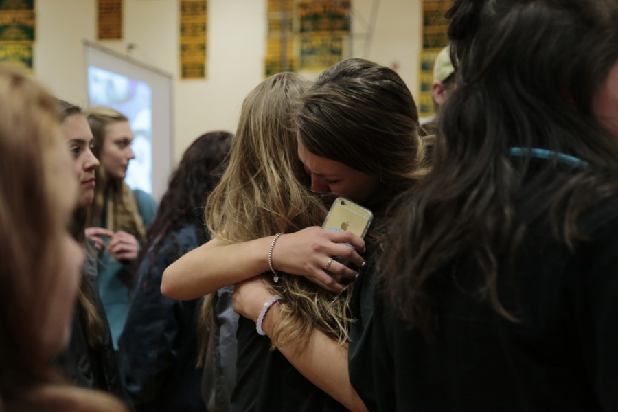 Taylor Finn (12), one of the two student council members involved with organizing the assembly, embraces a peer. Finn also helped organize the first Drive Smart assembly held in November, which, unlike Wednesday night's assembly, was mandatory for all MSHS students to attend, and occurred during school hours.