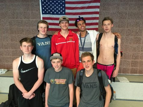 The Manitou swimmers before the start of the league meet.