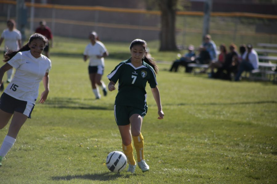 Abby Kingman (11) makes her way toward the goal during the first half of the game. Kingman has been playing soccer for all three years of her high school career.