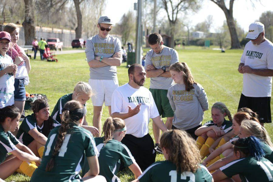 Head coach Benjamin Mack gives the team a pep talk during halftime, after four of the game's five total goals had been scored.