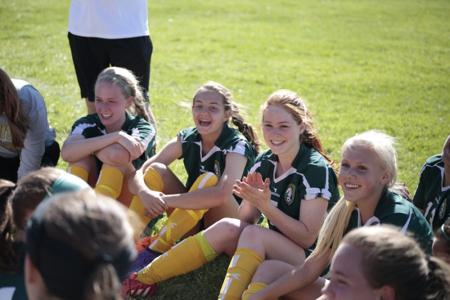 (from left to right) Teammates Morgan Warren (10), Brooklyn Mack (10), Ava Spangler (9), and Olivia McKenna (9) encourage teammate Meghann Root (11) to play goalie for the second half of the game in place of Mo Heiniger (11).