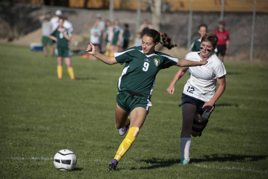 Brooklyn Mack (10) attempts to score during the second half of the game. Mack has been playing soccer since she was in elementary school, and broke a school-held record on Friday.