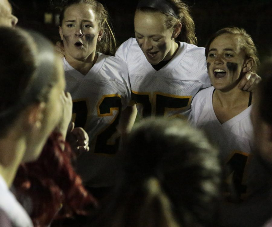 Maddie Grant (10), Bridget Bodor (10), and Trina Borst (10) participate in the team's motivational cheer.