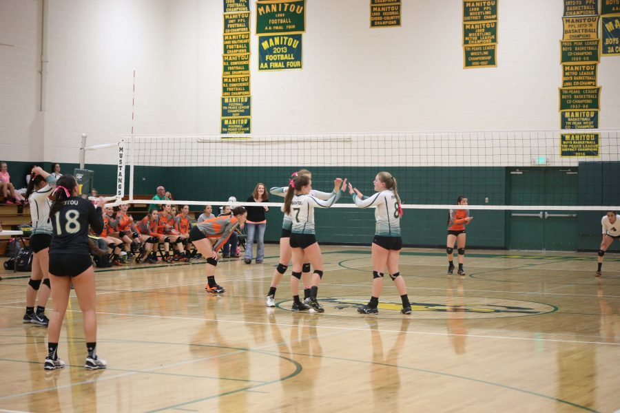 McKayla Cully (10), Abbie Boren (10), and Alex Riley (12) getting ready to hit some kills and put up a strong block