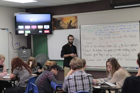 Pierce Gillard teaches one of his English classes at the beginning of his first year. The teacher, who is only 23 years old, has never held a teaching job before. He lived in Colorado Springs before he attended college, and jumped at the opportunity to teach at Manitou when he returned.