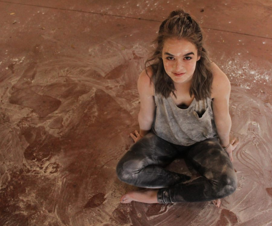 Jensen Delius (11) poses for a photo amid the flour she had been dancing in for the previous half hour. The markings that can be seen in the flour around her are indicative of the large amount and wide range of movement that goes into contemporary dance.