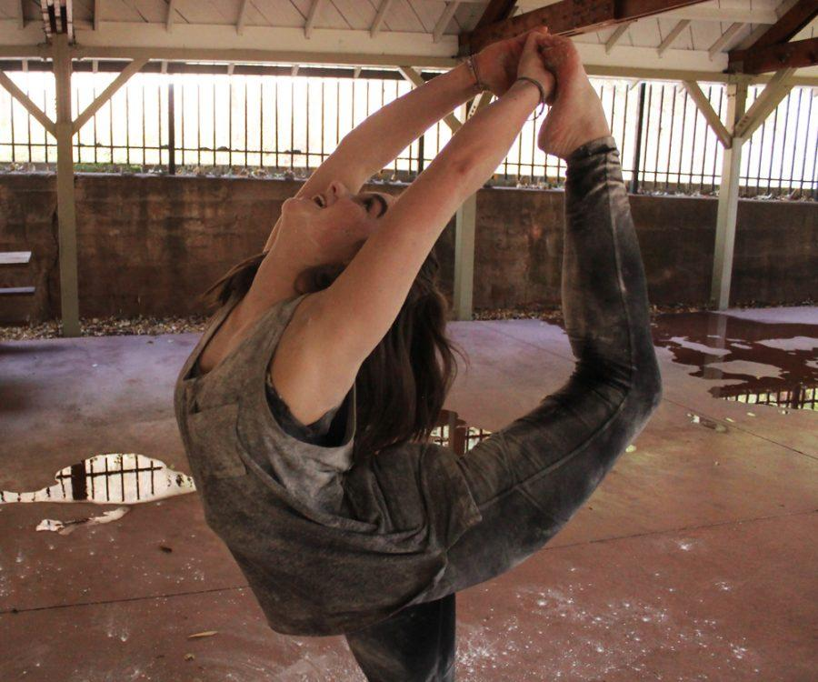 Jensen Delius (11) demonstrates a scorpion. This requires a large amount of flexibility, something that Delius has been able to strengthen her ability in throughout the course of her dance career.
