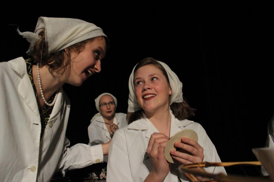 Kathryn (Alison Lanning) and Grace (Maggie Anderson) gossip about the events of the night before.