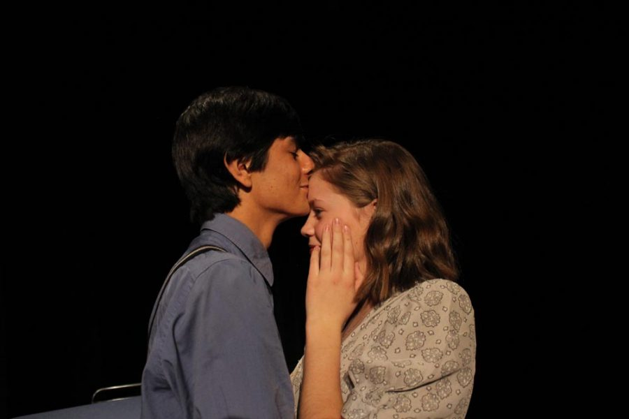Grace (Maggie Anderson) clutches her jaw in pain complaining of a tooth ache after kissing Tommy.