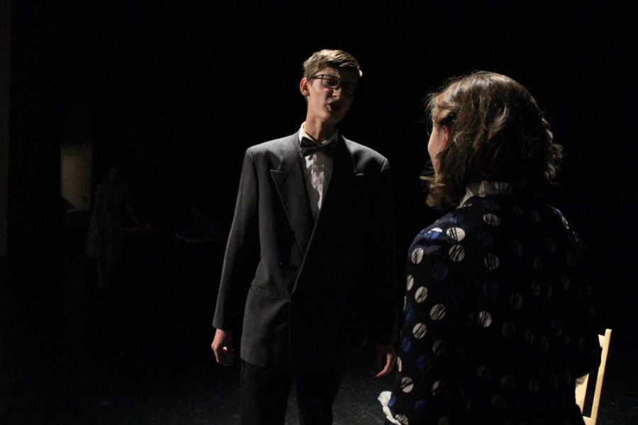 Arthur Roeder (Spencer Briggs-Hale) and his wife Diane (Autumn Gray) argue about the trial and if Arthur knew about the radium poisoning.