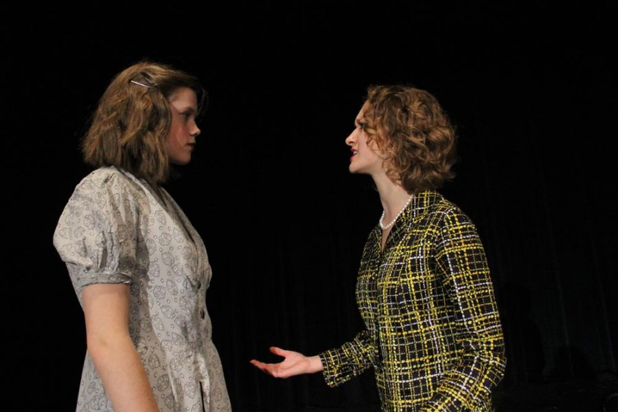 Kathryn (Alison Lanning) and Grace (Maggie Anderson) argue about Flinn's (Deven Gates) credibility.