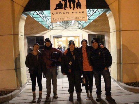 (from left to right) MSHS students Aubrey Hall (11), Tyler Jungbauer (11), Maya West (11) and GSTA advisor Mark Searle pose for a photo beneath the archway of Colorado Springs' First United Methodist Church, where the event was held. Students from Manitou Springs High School have participated in the night out for the past three years,  but participation in the event was first spearheaded by the GSTA last year.